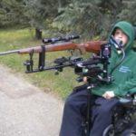 Boy in wheelchair with Sip and Puff Gun