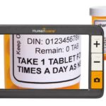 digital magnifier zooming in on a pill bottle